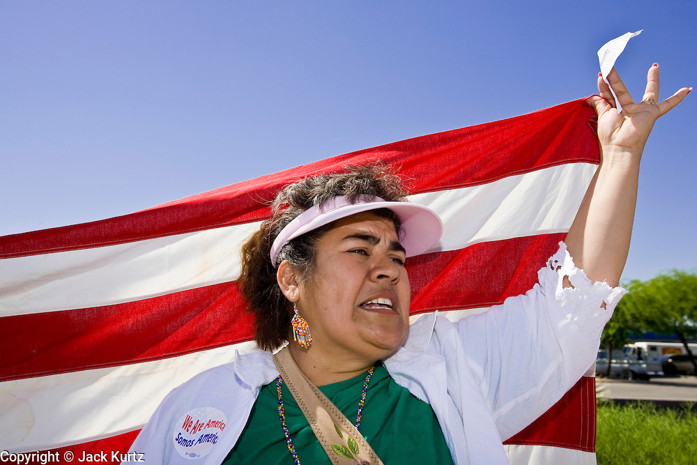 """01 MAY 2006 - PHOENIX, AZ: MARIA VAZQUEZ and about 1000 other immigrants gathered on a street corner in Phoenix at a Home Depot store during a protest in favor of immigration reform during the """"Day without Immigrants"""" protest in Phoenix. About 1,000 people picketed the corner, which had been a popular gathering spot for day laborers until Home Depot took action to keep day laborers off their property. Immigrants rights groups picketed two Home Depot stores, a pallet manufacturing plant and a public school during the protest. Photo by Jack Kurtz"""