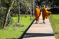 """Cambodian Monks at Neak Pean """"The entwined serpents"""" -  built on an artificial island with a Buddhist temple on a circular island and was constructed during the reign of King Jayavarman VII.  The temple and lake represent Anavatapta - a mythical lake in the Himalayas - with waters that are believe to cure illnesses. Neak Pean was set up for medical purposes.  The ancients believed that going into the pools would cure diseases based on the ancient Hindu belief of balance. Four connected pools represent Water, Earth, Fire and Wind. The stone statues in pavilions are meant to represent the heads of the Four Great Animals."""
