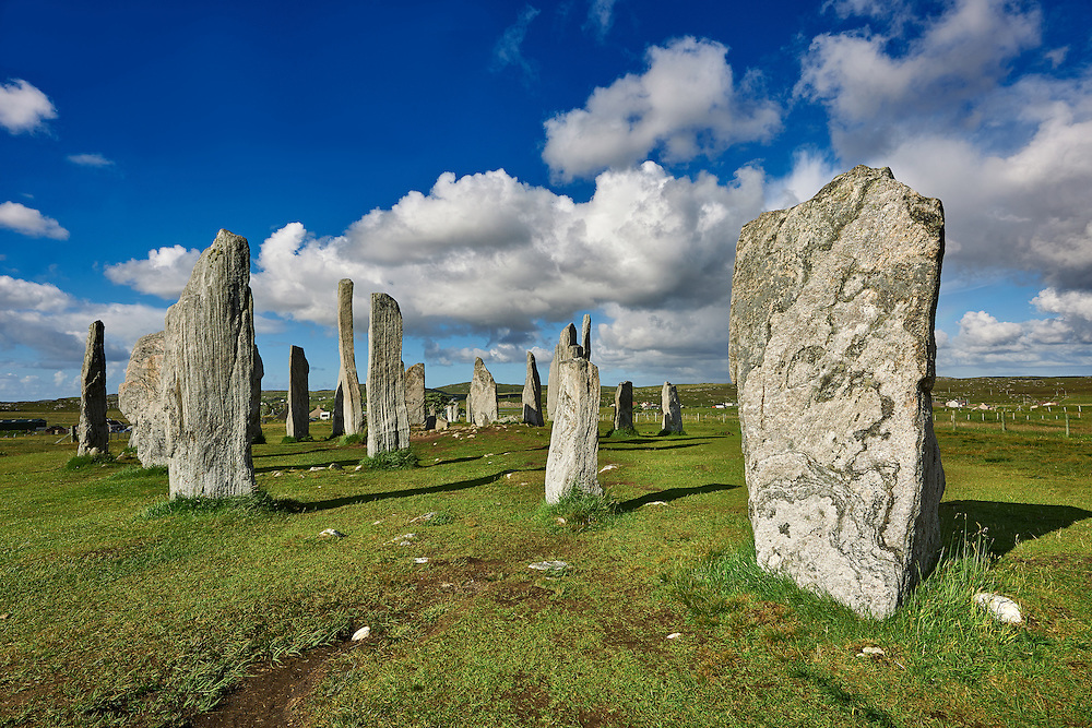 Outer row of stones, 27 metres long,  leading to the central stone circle, circa 2900BC .Calanais Neolithic Standing Stone (Tursachan Chalanais) , Isle of Lewis, Outer Hebrides, Scotland. .<br /> <br /> Visit our SCOTLAND HISTORIC PLACXES PHOTO COLLECTIONS for more photos to download or buy as wall art prints https://funkystock.photoshelter.com/gallery-collection/Images-of-Scotland-Scotish-Historic-Places-Pictures-Photos/C0000eJg00xiv_iQ<br /> '<br /> Visit our PREHISTORIC PLACES PHOTO COLLECTIONS for more  photos to download or buy as prints https://funkystock.photoshelter.com/gallery-collection/Prehistoric-Neolithic-Sites-Art-Artefacts-Pictures-Photos/C0000tfxw63zrUT4