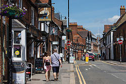 Wokingham, UK. 8th June, 2021. Shoppers pass through the town centre amid rising local concern regarding the spread of the Covid-19 Delta variant. Surge testing has been introduced in some local postcodes after a small number of cases of the Delta variant first identified in India were confirmed in the Wokingham area.