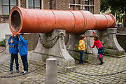 Children playing at the big cannon called Dulle Griet, ghent, Belgium, 07.11.2015