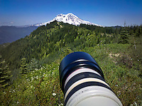 Mount Rainier viewed from the Tahoma State Forest with Mount Tahoma Trails Association's High Hut cross country ski trail hut seen against the mountain.  The lens in the foreground is a Canon 100-400mm  WA USA