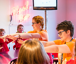 City Arts Centre, Edinburgh, Scotland, United Kingdom, 9 April 2019. Edinburgh Science Festival:  Children have fun learning about blood at the Blood Bar drop in event with Science Communicators Emma and Hannah at the Science Festival. <br /> <br /> Sally Anderson | EdinburghElitemedia.co.uk