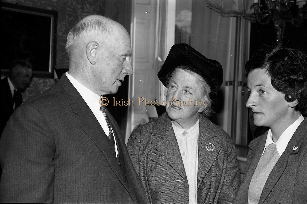 """3/05/1966<br /> 05/23/1966<br /> 23 May 1966<br /> 1916 Art prizes presented at Iveagh House. Prizes for literature, music and art offered by the 1916 Golden Jubilee Commemoration Committee were presented by the Minister for Education Mr. George Colley T.D. at a ceremony at Iveagh House, Dublin. Picture shows (l-r): Mr. Florence O'Donoghue, Loughlene, Eglantine Park, Douglas Road, Cork, who won a prize of £200 for his literary work """"The failure of the German Arms landing at Easter 1916 - a new interpretation"""" with Mrs Florence O'Donoghue and Miss B. McCoy, Douglas Road, Cork, after the ceremony."""
