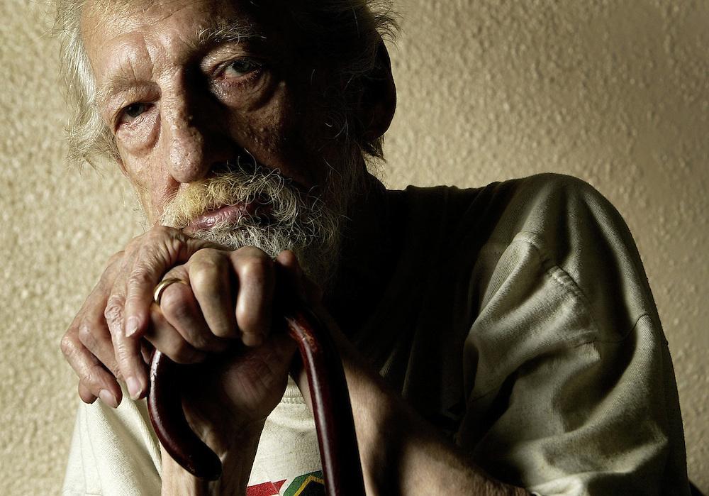 Poet and former journalist John Doig, 69, is seen in his Vanier apartment in Ottawa on Nov 25, 2006. .(Ottawa Sun Photo By Sean Kilpatrick)