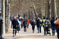 © Licensed to London News Pictures. 11/04/2021. London, UK. Members of the public exercise in a sunny <br /> St James's Park in central London. Temperatures are expected to rise with highs of 15 degrees forecasted for parts of London and South East England later this week . Photo credit: George Cracknell Wright/LNP