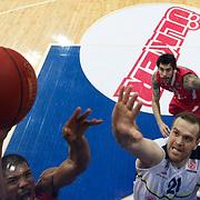 Fenerbahce Ulker's Oguz Savas (C) during their Euroleague Basketball Top 16 Game 13 match Fenerbahce Ulker between Olympiacos at Fenerbahce Ulker Sports Aren in Istanbul, Turkey, Thursday, March 29, 2013. Photo by TURKPIX