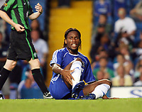 Photo: Chris Ratcliffe.<br /> Chelsea v Glasgow Celtic. Pre Season Friendly. 09/08/2006.<br /> Didier Drogba lies injured.