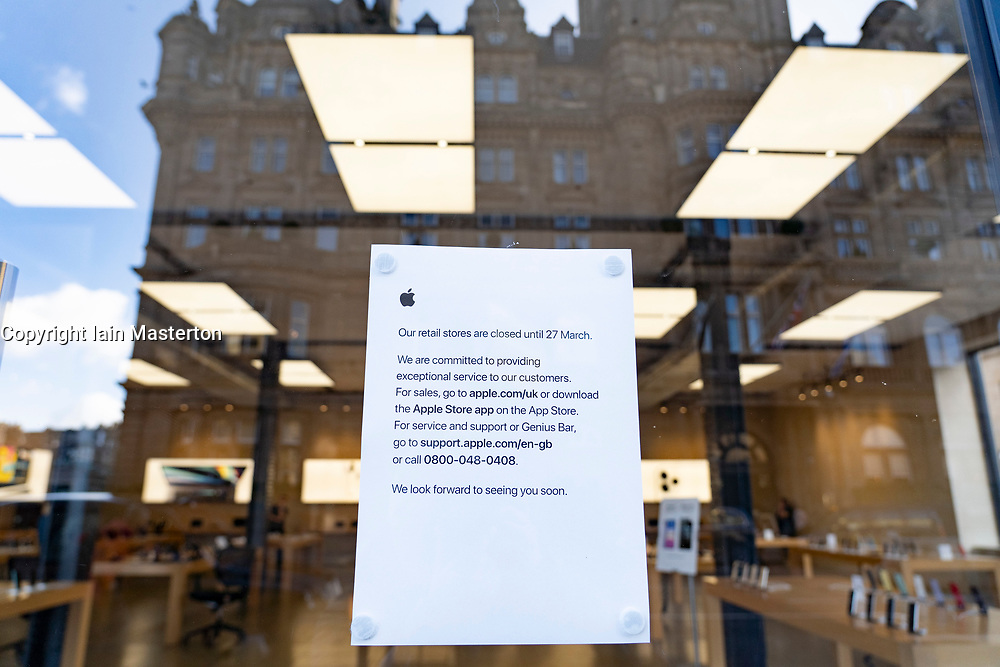 Edinburgh, Scotland, UK. 16 March, 2020. Effects of Coronavirus in Edinburgh City Centre today. Notice on door of empty Apple store on Princes Street stating that shop is closed until 27 March. Iain Masterton/ Alamy Live News
