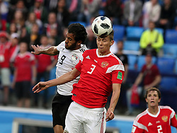 June 19, 2018 - St. Petersburg, Russia - 19 June 2018, Russia, St. Petersburg, FIFA World Cup 2018, First Round, Group A, First Matchday, Russia v Egypt. Player of the national team Marwan Mohsen (9), Ilya Kutepov  (Credit Image: © Russian Look via ZUMA Wire)
