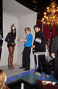 Naomi Campbell, Philip Treacy and David la Chapelle,  Tanqueray Philip Treacy couture fashion show and after party,  Pink Paradise Club, Paris. 21 January 2003. © Copyright Photograph by Dafydd Jones 66 Stockwell Park Rd. London SW9 0DA Tel 020 7733 0108 www.dafjones.com