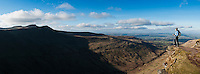 Female hiker enjoys panoramic view from Fan Y Big across Cwmcynwyn, Brecon Beacons national park, Wales