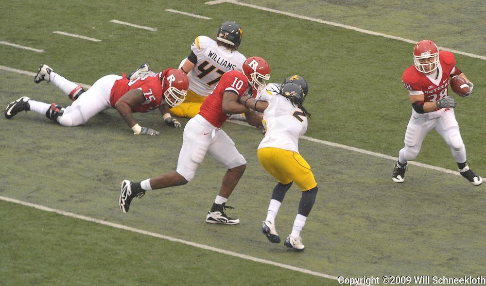 Dec 5, 2009; Piscataway, NJ, USA; Rutgers running back Joe Martinek (38) runs the ball during first half NCAA Big East college football action between Rutgers and West Virginia at Rutgers Stadium.