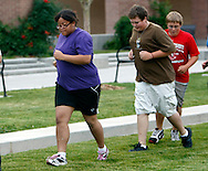 Tatianna Anderson, 17; Micah Peterson, 15 and Daniel Barton 14 run at a group exercise session in the 10-week Shapedown Program at The Children's Hospital in Aurora, Colorado July 8, 2010.  The program is part of the child and teen weight management program at the hospital. REUTERS/Rick Wilking (UNITED STATES)