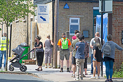 © Licensed to London News Pictures 08/06/2021. <br /> Sidcup, UK. People queueing in Sidcup, South East London today to get their Coronavirus vaccine at a Covid-19 vaccination centre just off the High Street. Under 30s have been invited to get a vaccination from today. Photo credit:Grant Falvey/LNP