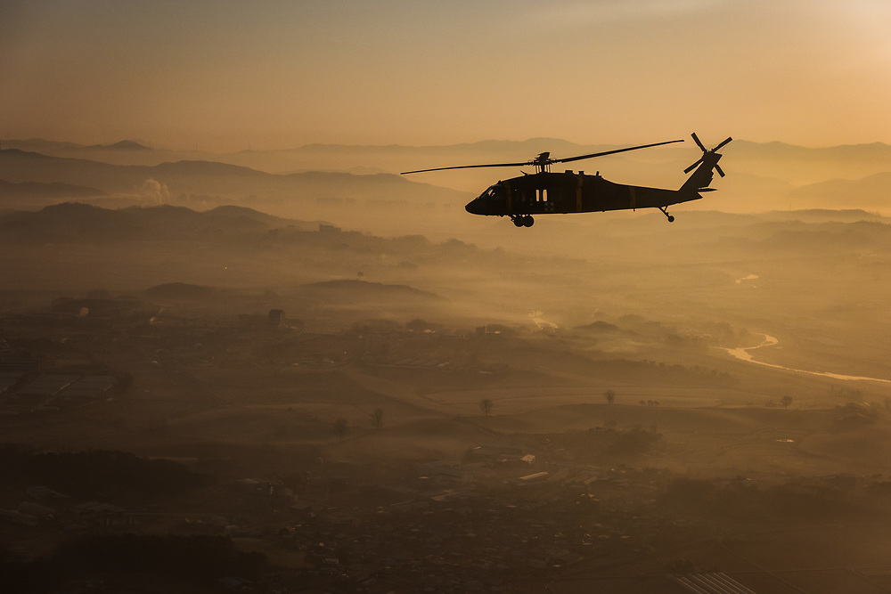 UH-60A/L Blackhawk with C Co, 3-2 GSAB flies over South Korea at dawn during Key Resolve '16
