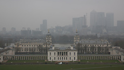 © Licensed to London News Pictures. 19/03/2015. Photo from Greenwich as toxic smog covers large parts of the UK. Visibility has been badly reduced while there have been warnings about the quality of the air.  Comparison photos available in the same set. Credit : Rob Powell/LNP