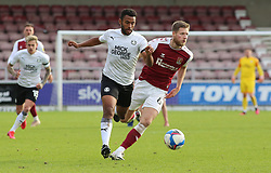 Nathan Thompson of Peterborough United in action with Fraser Horsfall of Northampton Town - Mandatory by-line: Joe Dent/JMP - 10/10/2020 - FOOTBALL - PTS Academy Stadium - Northampton, England - Northampton Town v Peterborough United - Sky Bet League One