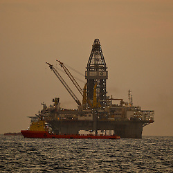 The Transocean Development Driller III works to drill the primary relief well at the BP Plc Macondo well site in the Gulf of Mexico off the coast of Louisiana, U.S., on Friday, July 30, 2010. BP Plc continues to work on a relief well to permanently plug the source of the largest oil spill in U.S. history.  Photographer: Derick E. Hingle/Bloomberg