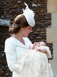 File photo dated 05/07/15 of the Duchess of Cambridge carrying Princess Charlotte as they arrive at the Church of St Mary Magdalene in Sandringham, Norfolk, as Princess Charlotte was christened in front of the Queen and close family. Princess Charlotte celebrates her fifth birthday today.