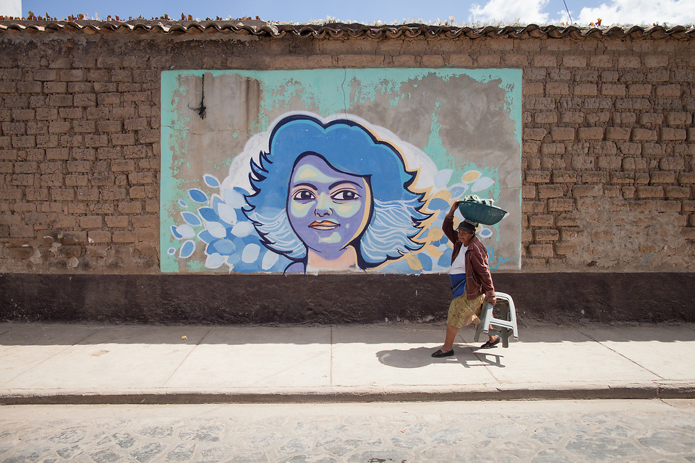 A mural with the face of Lenca leader Berta Cáceres is painted on the wall of the penitentiary at La Esperanza, Intibucá, the town where she was assassinated.