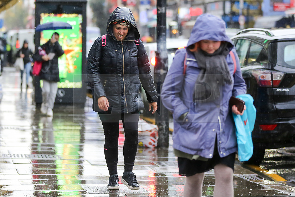 © Licensed to London News Pictures. 14/11/2020. London, UK. People are caught in the rain in north London. The Met Office has issued a yellow weather warning for the UK for heavy rain and strong winds, as up to 20 days worth of rain is expected to fall in the next few days. Photo credit: Dinendra Haria/LNP