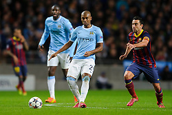 Man City Midfielder Fernandinho (BRA) is challenged by Barcelona Midfielder Xavi (ESP) - Photo mandatory by-line: Rogan Thomson/JMP - Tel: 07966 386802 - 18/02/2014 - SPORT - FOOTBALL - Etihad Stadium, Manchester - Manchester City v Barcelona - UEFA Champions League, Round of 16, First leg.