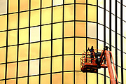 A window repairman inspect one of the gold window on the the Crossroads Executive Centre at 3601 Golf Road in Rolling Meadows, Illinois on Wednesday, June 3, 2020.