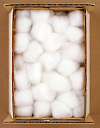 A carton box of cotton balls