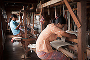 Weavers at the Ko Than Hlaing Weaving Factory built on Inle Lake in Shan State, Myanmar