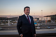 Dr Mustafa Palancioglu stands outside the Ommer Hotel, where the ruling AKP held it's business forum in Kayseri, Turkey. Behind are two newly built bus terminals serving rural and national destinations.