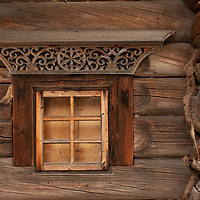 Intricate carvings and a window punctuate the log wall of an historic house relocated to the Malye Korely outdoor museum, near the northern port of Arkhangel'sk.