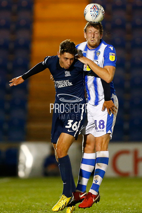 Colchester United defender Thomas Eastman (18) heads the ball during the EFL Trophy match between Colchester United and Southend United at the Weston Homes Community Stadium, Colchester, England on 9 October 2018.
