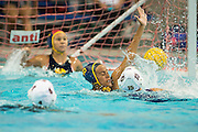 Tsegenet Awoke (16) attempts to block a Monta Vista shot during a girl's varsity water polo match at Milpitas High School in Milpitas, California, on September 6, 2016. (Stan Olszewski/SOSKIphoto)