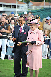 HM THE QUEEN and MR KHALAF AL HABTOOR (in waistcoat) at Al Habtoor Royal Windsor Cup Final 2012 at Guards Polo Club, Berkshire on 24th June 2012.