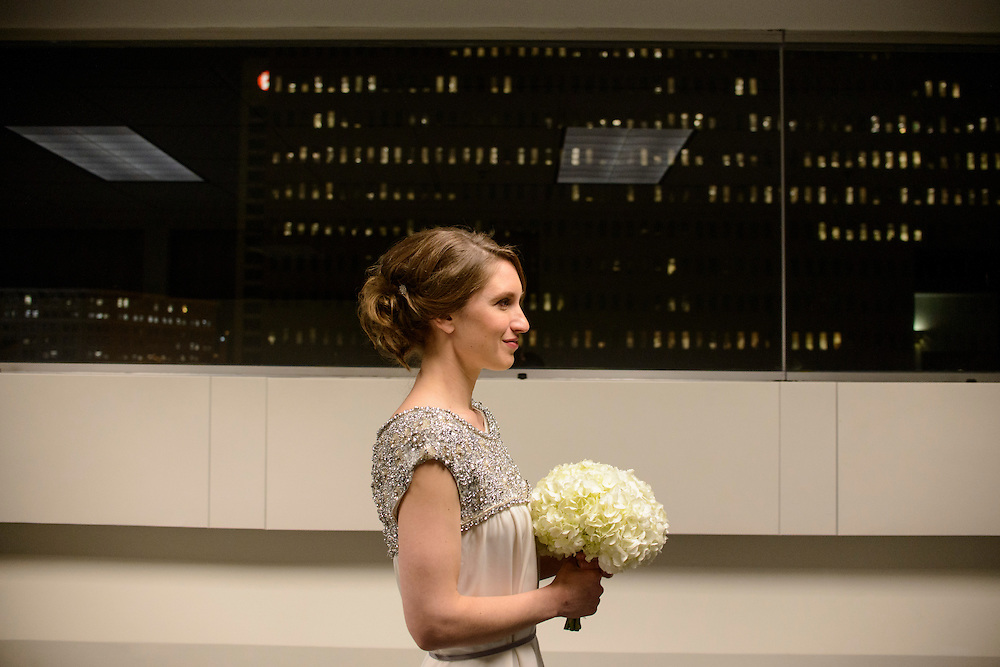 Photo by Matt Roth.Assignment ID: 10135450A..Moments before the start of her wedding ceremony, Cara Ann Shepley, a law clerk from Baltimore, walks down the 7th floor hallway of the Garmatz Federal Courthouse in Baltimore, Maryland on Wednesday, December 12, 2012. She married Genshi Ezawa, a Zen Buddhist priest from Japan, and the ceremony was performed by Ms. Shepley's boss, soon to be retired U.S. District Court Judge Benson Everett Legg, in what might be his last official duty as a sitting judge.