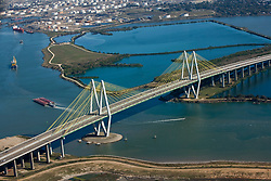 Afternoon aerial view of the Fred Hartman Bridge with ships passing underneath