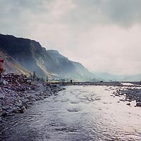 A Nepali villager walks beside Seti River, Nepal