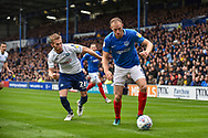 Portsmouth Defender, Matt Clarke (5) holds off Wycombe Wanderers Defender, Jason McCarthy (26) during the EFL Sky Bet League 1 match between Portsmouth and Wycombe Wanderers at Fratton Park, Portsmouth, England on 22 September 2018.