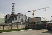 Chernobyl, Exclusion Zone, Ukraine. The  Chernobyl Reactor which is still being welded together to protect its contents.  just before the 20th anniversary of the nuclear disaster.