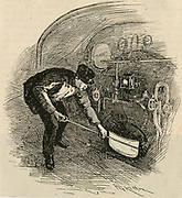 Fireman shovelling coal into the furnace of the 'Flying Scotsman' the locomitive of the express railway train between King's Cross station, London and Edinburgh.  Engraving, 1892.
