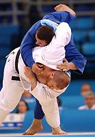 Selim Tataroglu (Turkey) throws  in his bout with Lasha Gujejiani (Georgia) Mens 100kg+ Judo, Athens Olympics, 20/08/2004. Credit: Colorsport / Matthew Impey DIGITAL FILE ONLY