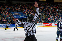 KELOWNA, CANADA - FEBRUARY 13: Linesman Tim Plamondon makes a call at the Kelowna Rockets against the Seattle Thunderbirds on February 13, 2017 at Prospera Place in Kelowna, British Columbia, Canada.  (Photo by Marissa Baecker/Shoot the Breeze)  *** Local Caption ***