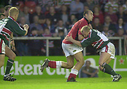 Leicester, Welford Road, Leicestershire, 30/09/2001,          Llanelli's, Chris Wyatt, is held up by, Leicester flanker Neil Back, during the,  Heineken Cup, match, Leicester Tigers vs Llanelli, Heineken Cup,<br /> [Mandatory Credit: Peter Spurrier/Intersport Images],<br /> Leicester Tigers v Llanelli Euro Cup  <br /> 29/9/01