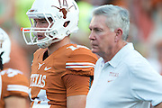 AUSTIN, TX - AUGUST 31: David Ash #14 of the Texas Longhorns stands next to head coach Mack Brown before kickoff against the New Mexico State Aggies on August 31, 2013 at Darrell K Royal-Texas Memorial Stadium in Austin, Texas.  (Photo by Cooper Neill/Getty Images) *** Local Caption *** David Ash; Mack Brown