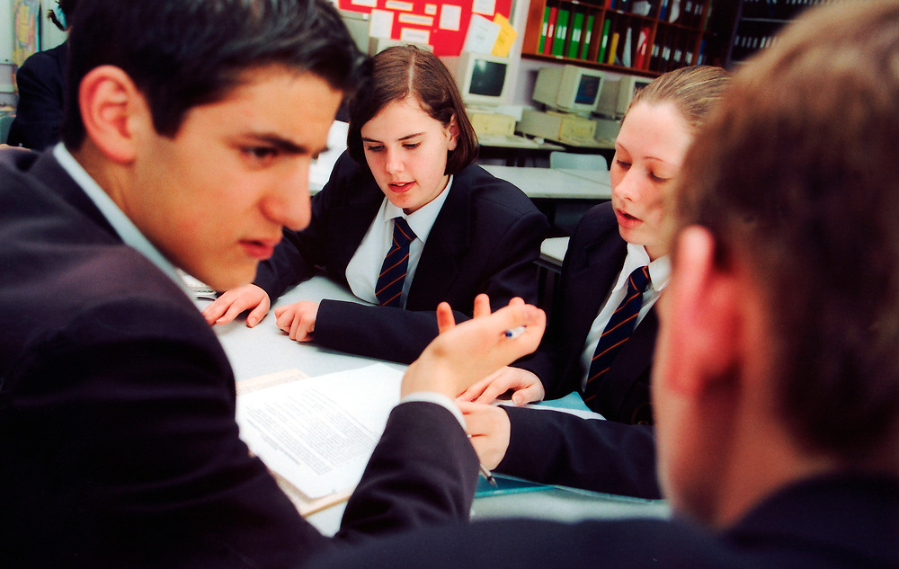 GCSE business studies students doing group exercise at secondary school; Woking; Surrey UK