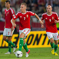 Hungary's Balazs Dzsudzsak (C) leads the ball during a World Cup 2014 qualifying soccer match Hungary playing against Netherlands in Budapest, Hungary on September 11, 2012. ATTILA VOLGYI
