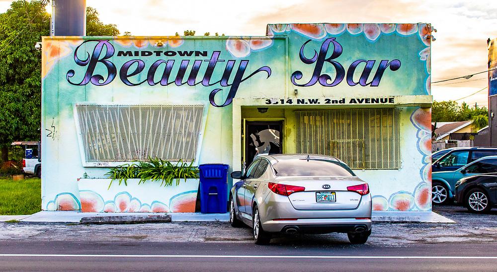 Beauty salon in a mural covered Miami Modern building in Miami's Buena Vista West neghborhood