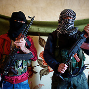 January 18, 2012 - Idleb, Syria: Two Free Syria Army soldiers pose for a portrait in a safe house in a location near the revolution stronghold city of Idleb.
