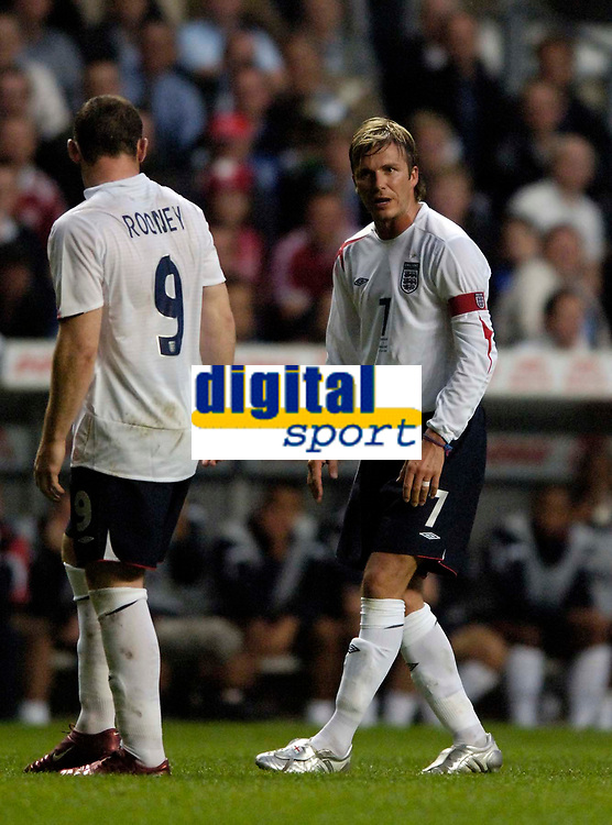 Fotball<br /> England 2005/2006<br /> Foto: SBI/Digitalsport<br /> NORWAY ONLY<br /> <br /> Danmark v England<br /> <br /> International Friendly. 17/08/2005.<br /> <br /> England's David Beckham (R) tells Wayne Rooney to calm down as the youngster threatens to lose his cool.